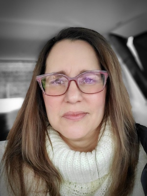 long-haired woman in glasses