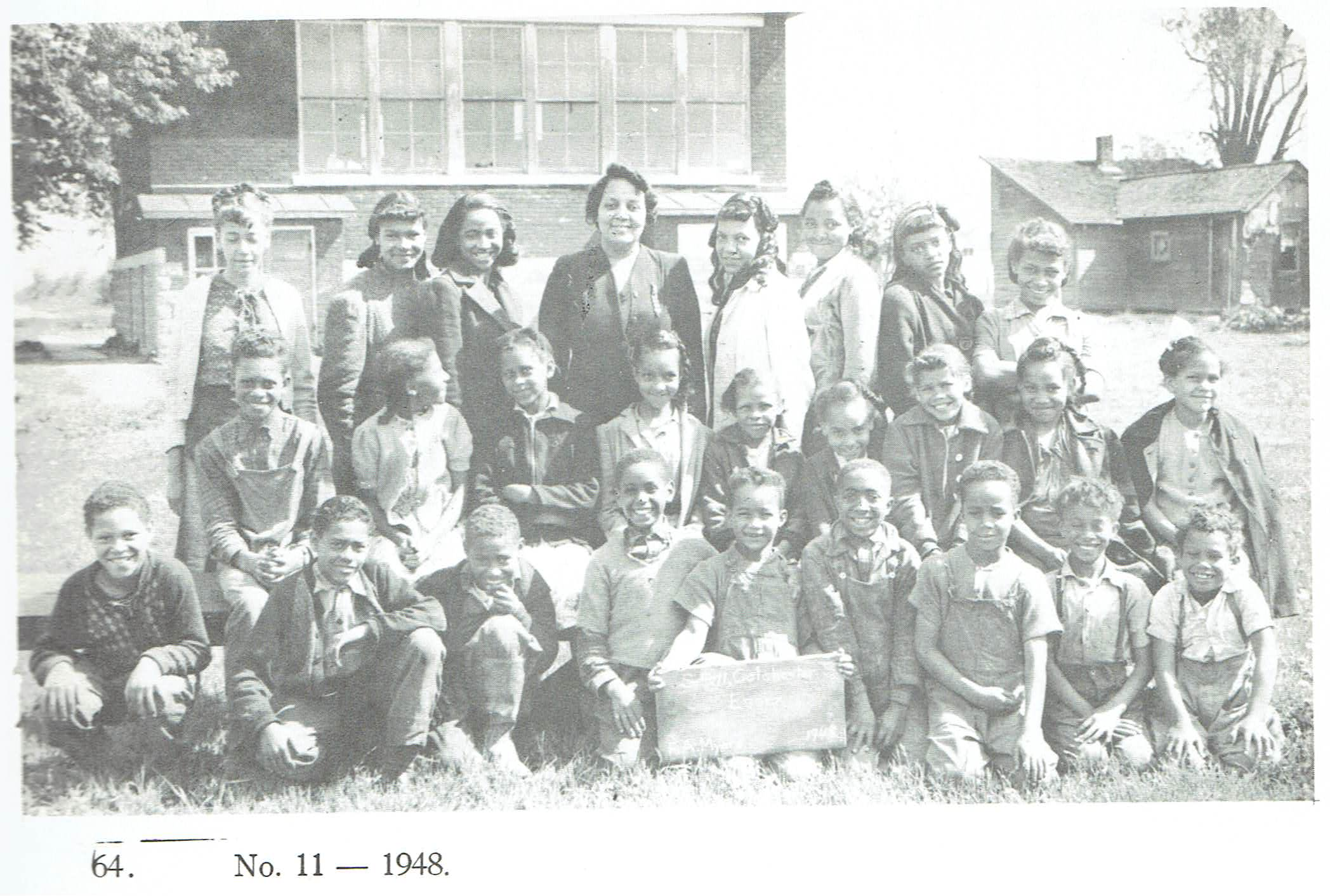 a black and white archival photo of children at school