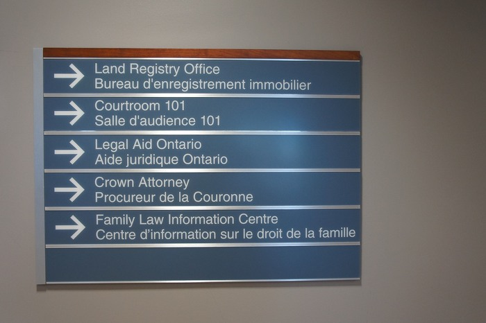 Bilingual signage in a court house.