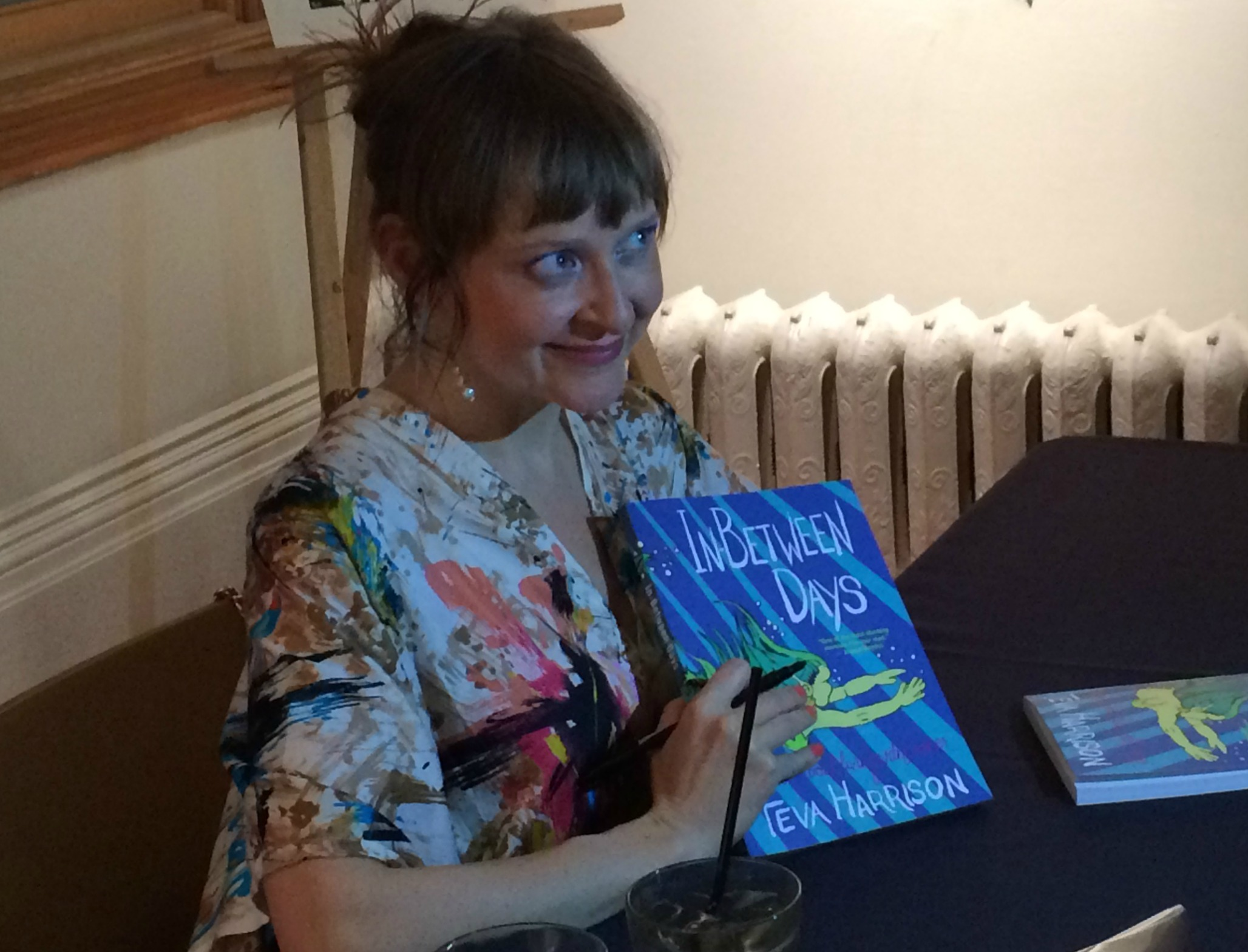 Author Teva Harrison signs books at the launch of her new graphic memoir about living with cancer.