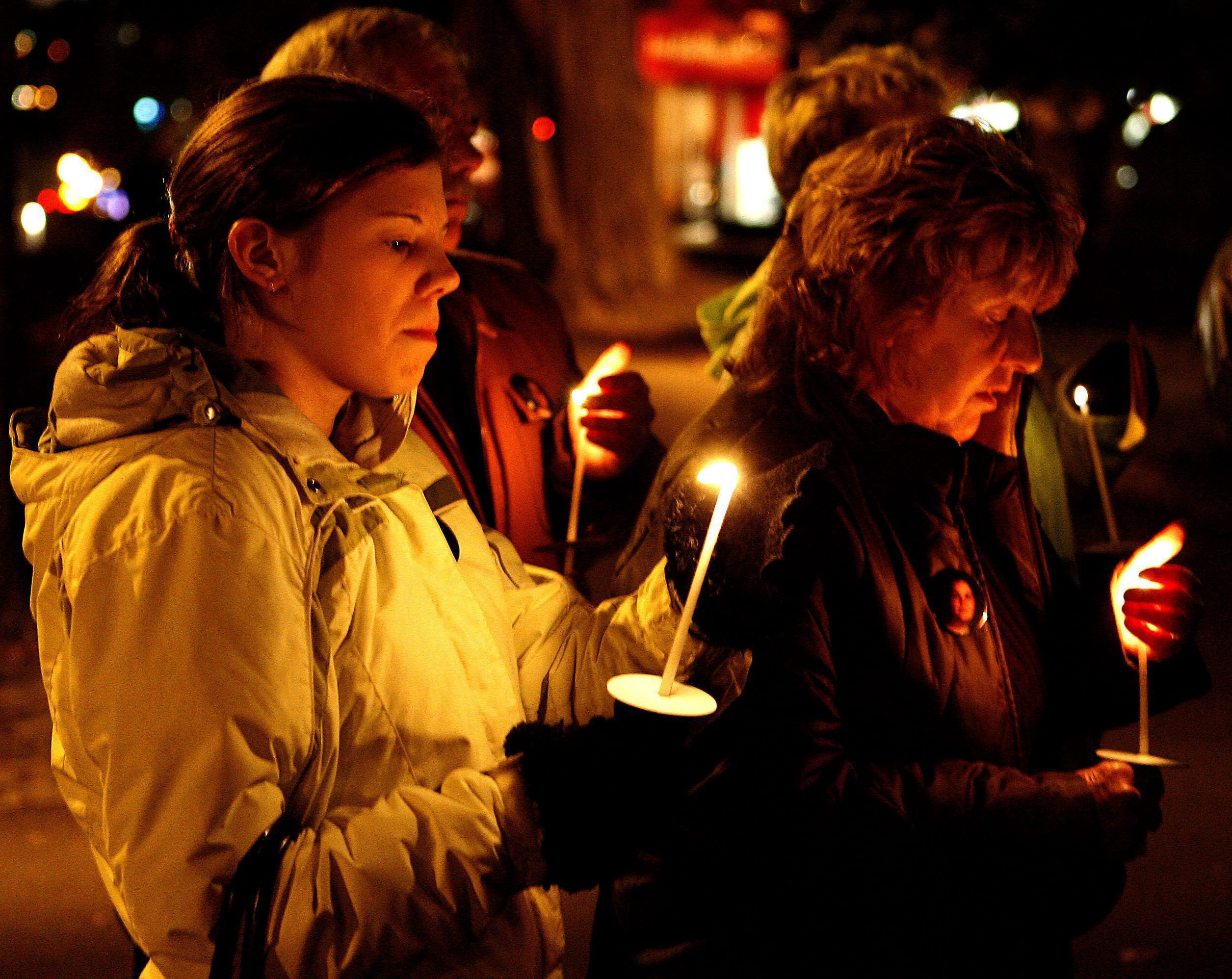 a group of people at a candle light vigil