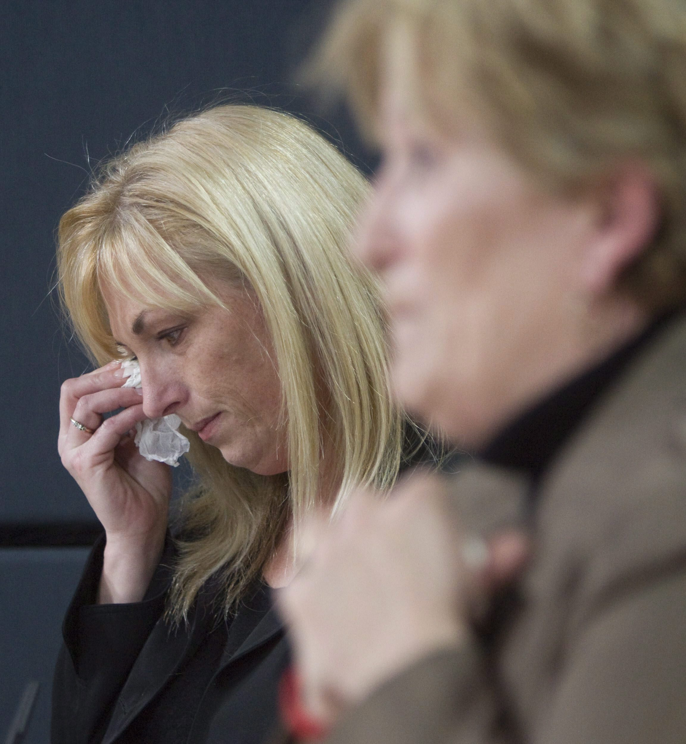 Ashley Smith's sister cries as she and her mother speak with reporters.