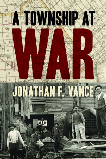 cover of the book, A Township at War, showing wartime life