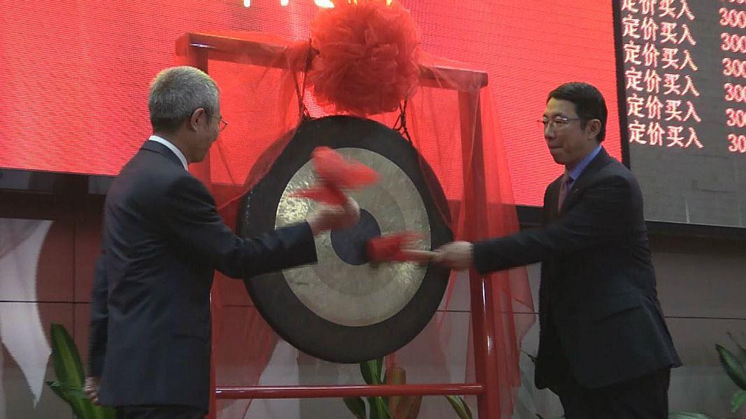 two men banging a gong