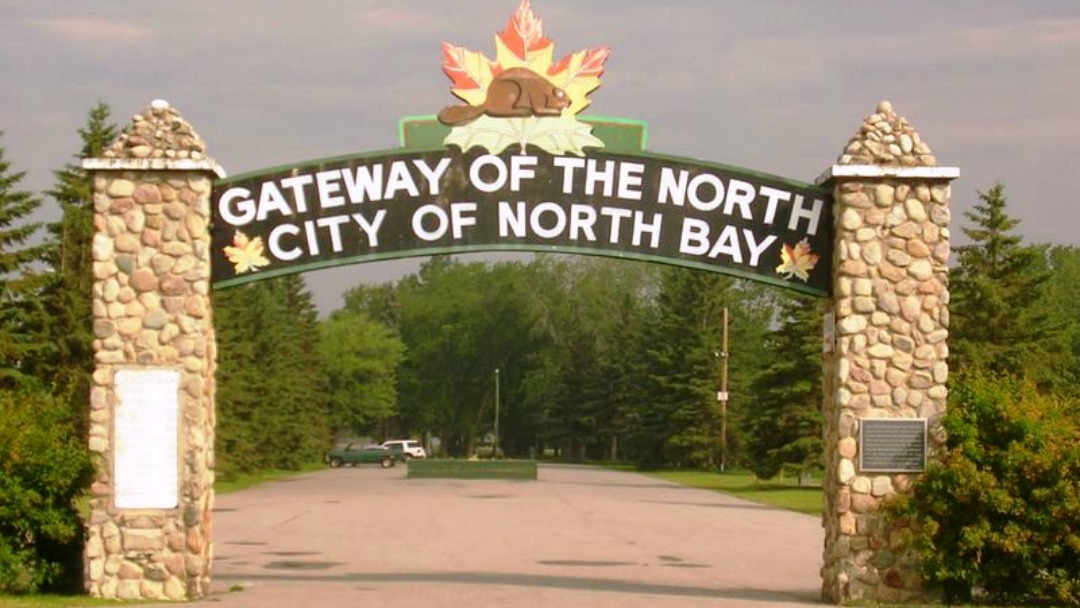 "Sign over road that says ""Gateway of the North - City of North Bay"""