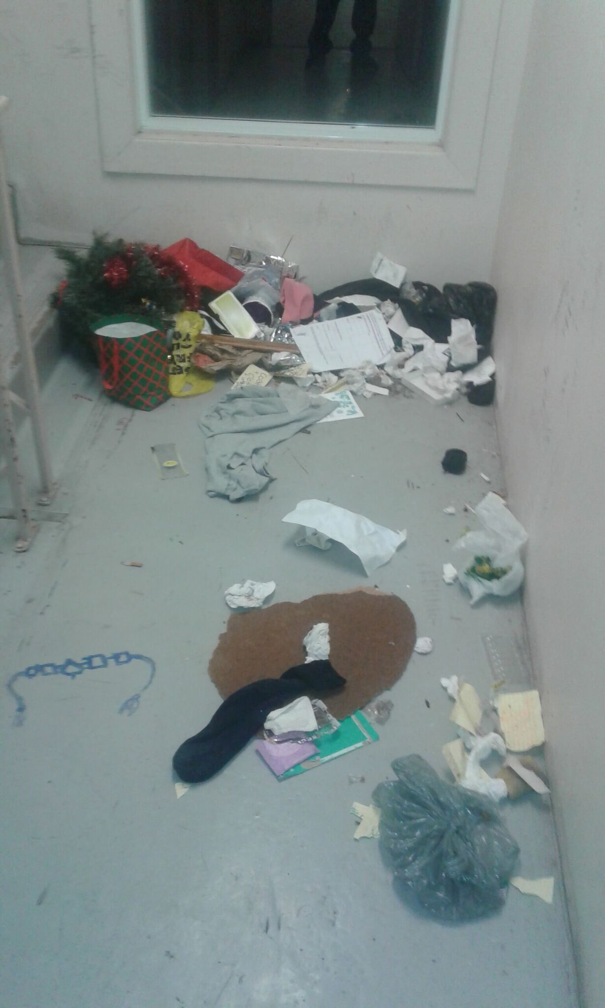 a hallway strewn with clothing and other items
