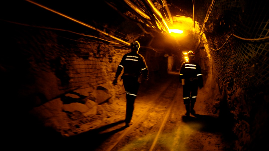 miners walking in shaft