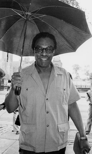 smiling man holding an umbrella