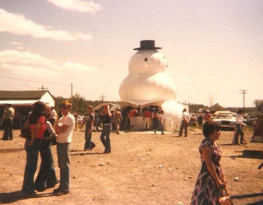 a large snowman sculpture with a built-in concession stand