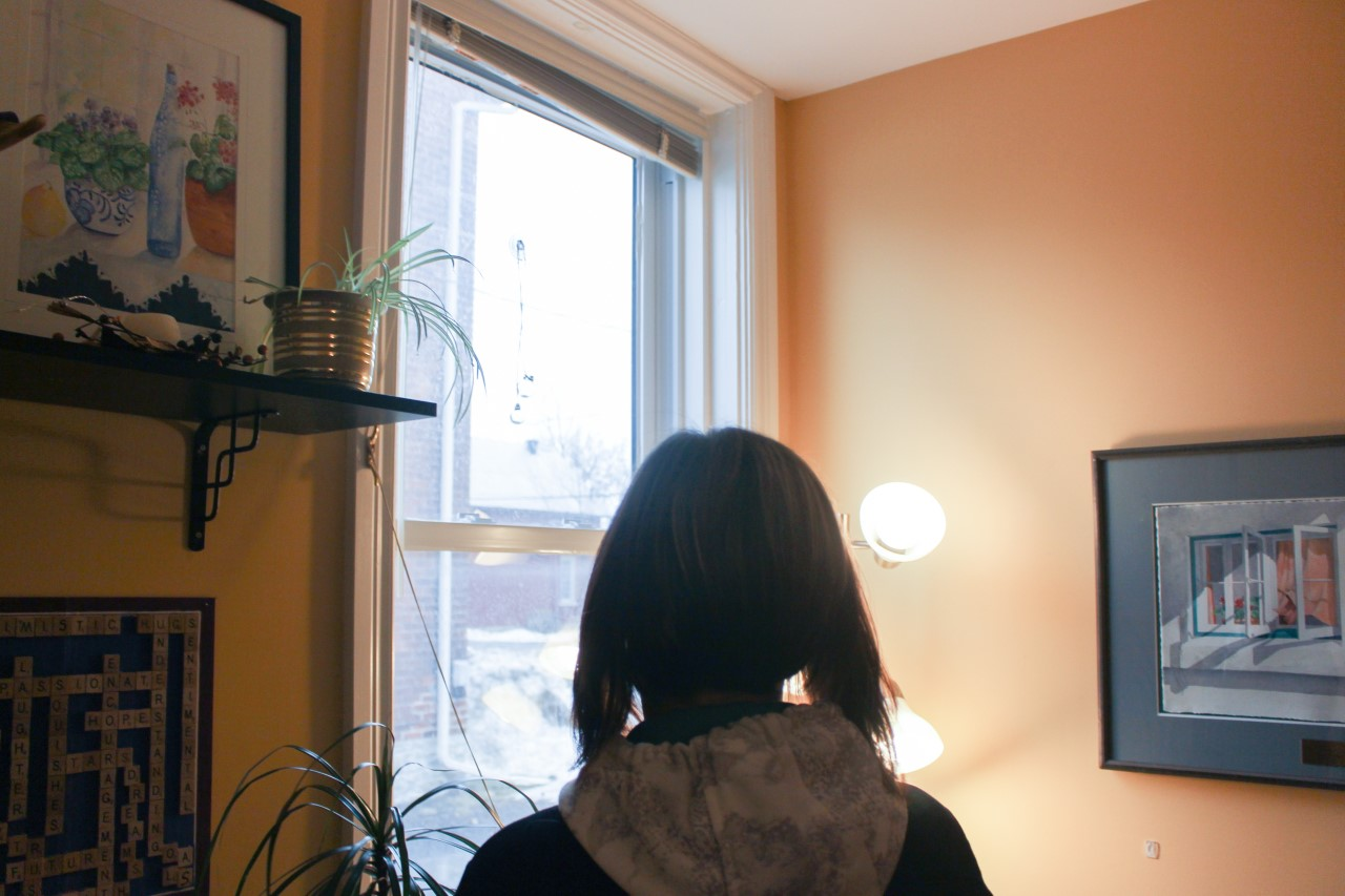 a woman stares out a window
