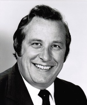 black and white photo of a smiling man