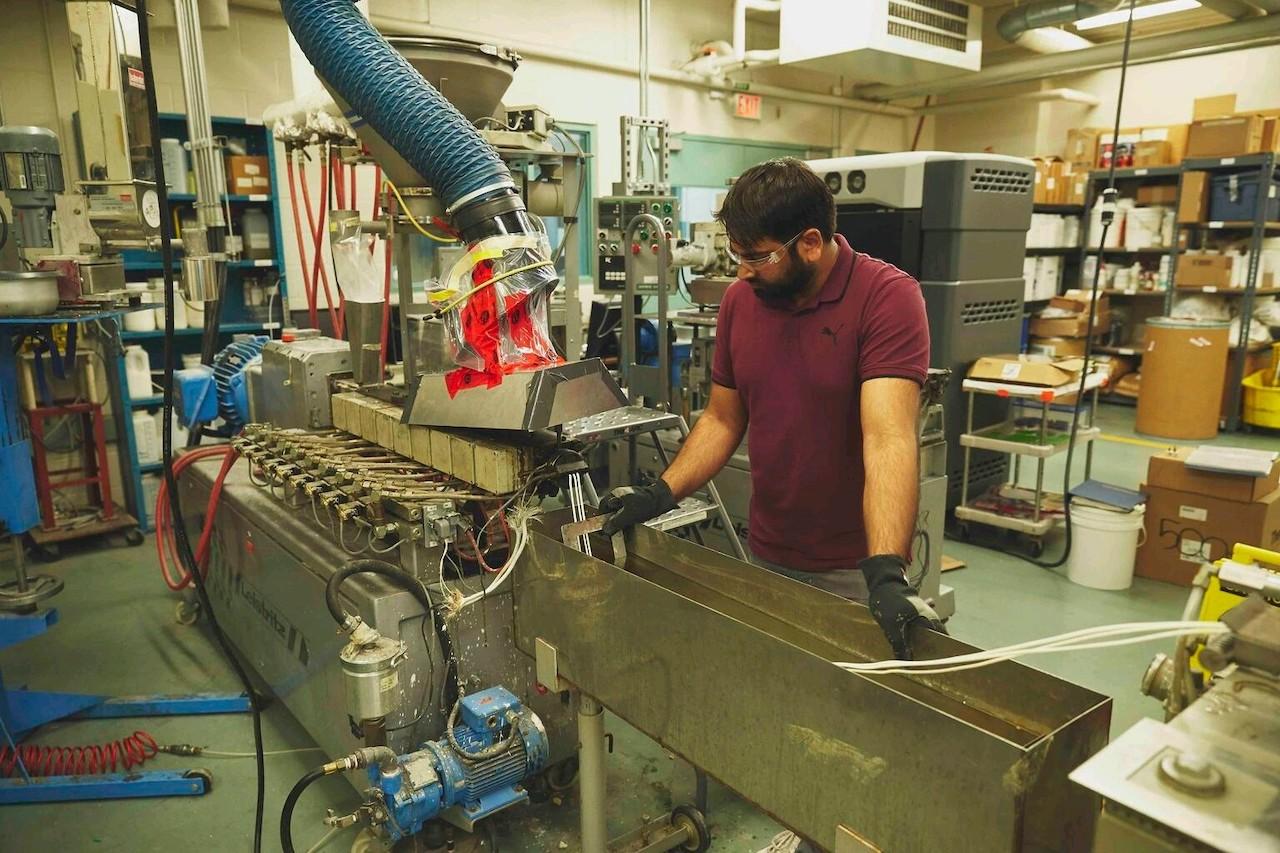 a man works at a machine