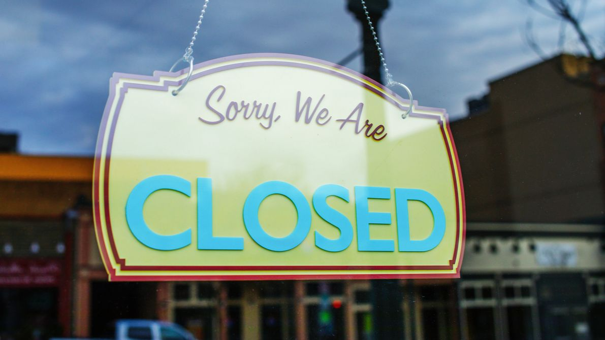 """Store sign that says """"closed."""""""