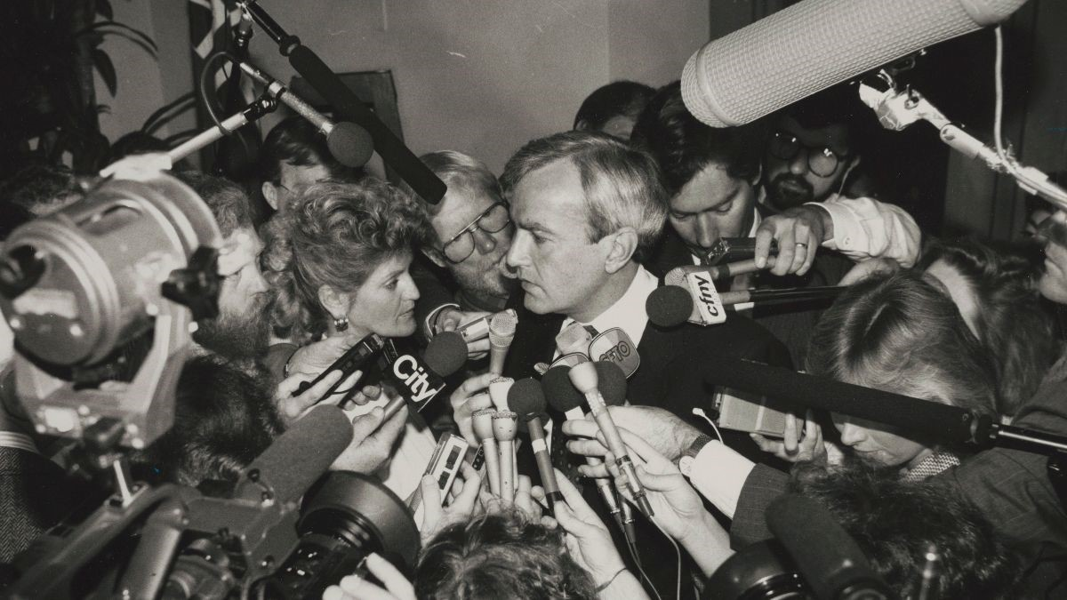 Man surrounded by microphones