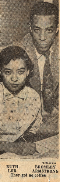 black and white photo of a seated woman and standing man