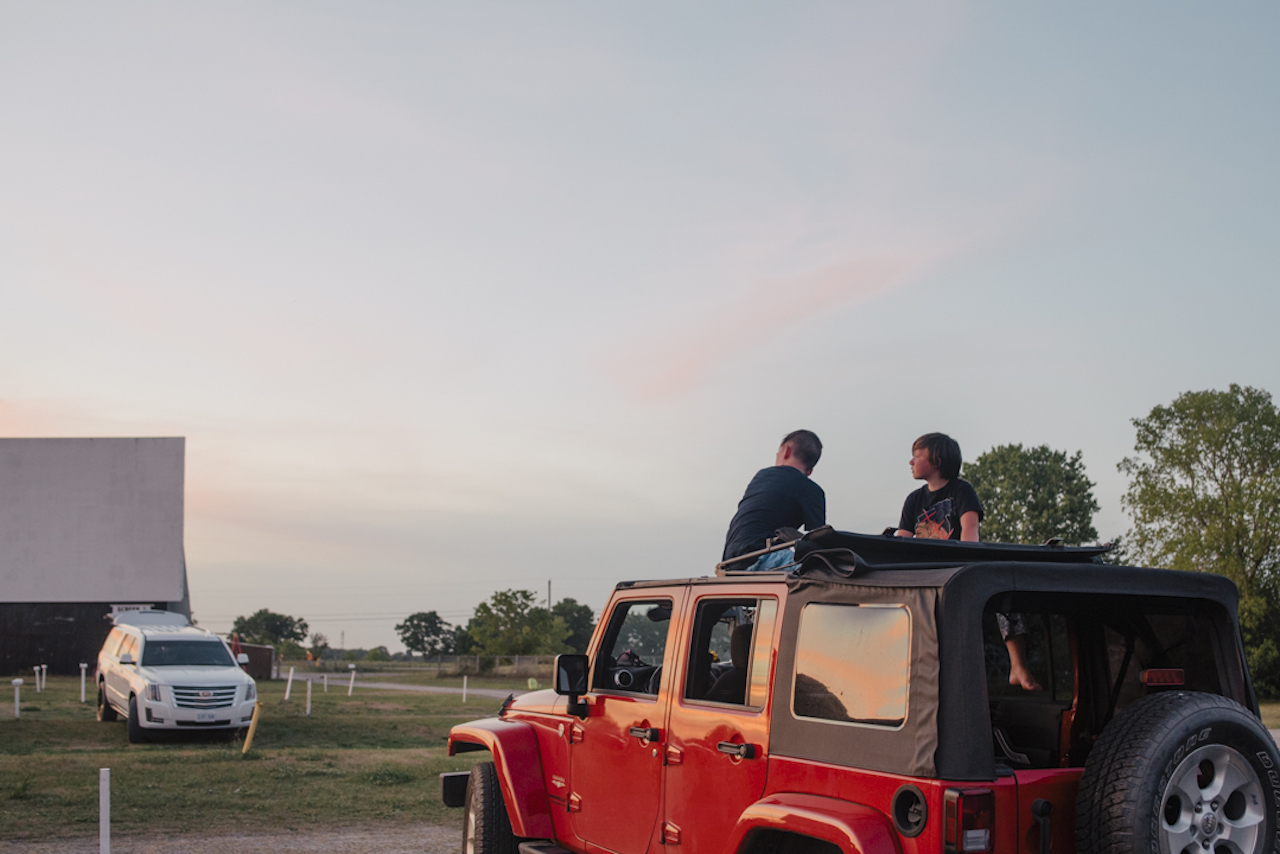 two boys in a Jeep