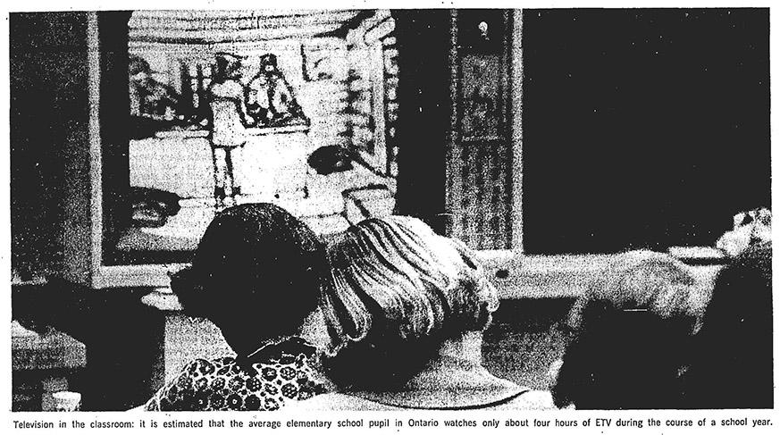 black and white photo of children watching TV
