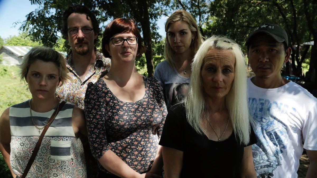 Six Australians standing in a line.