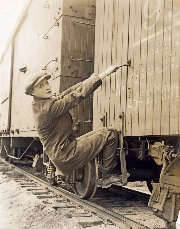 woman holding on to the side of a train