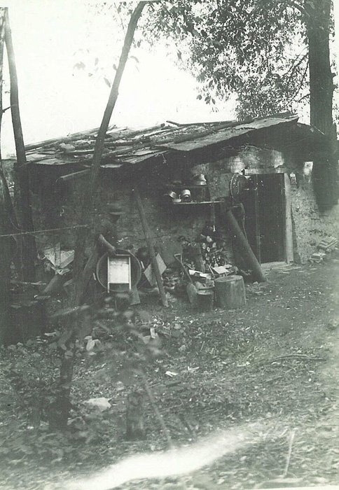 black and white photo of a homemade shelter