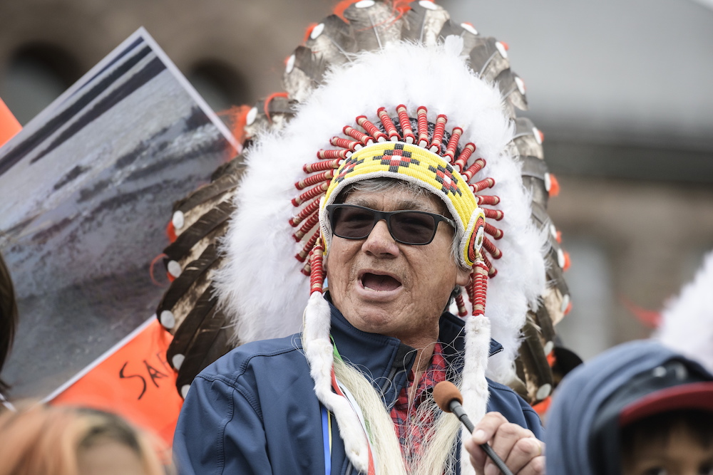 a man in headdress and sunglasses