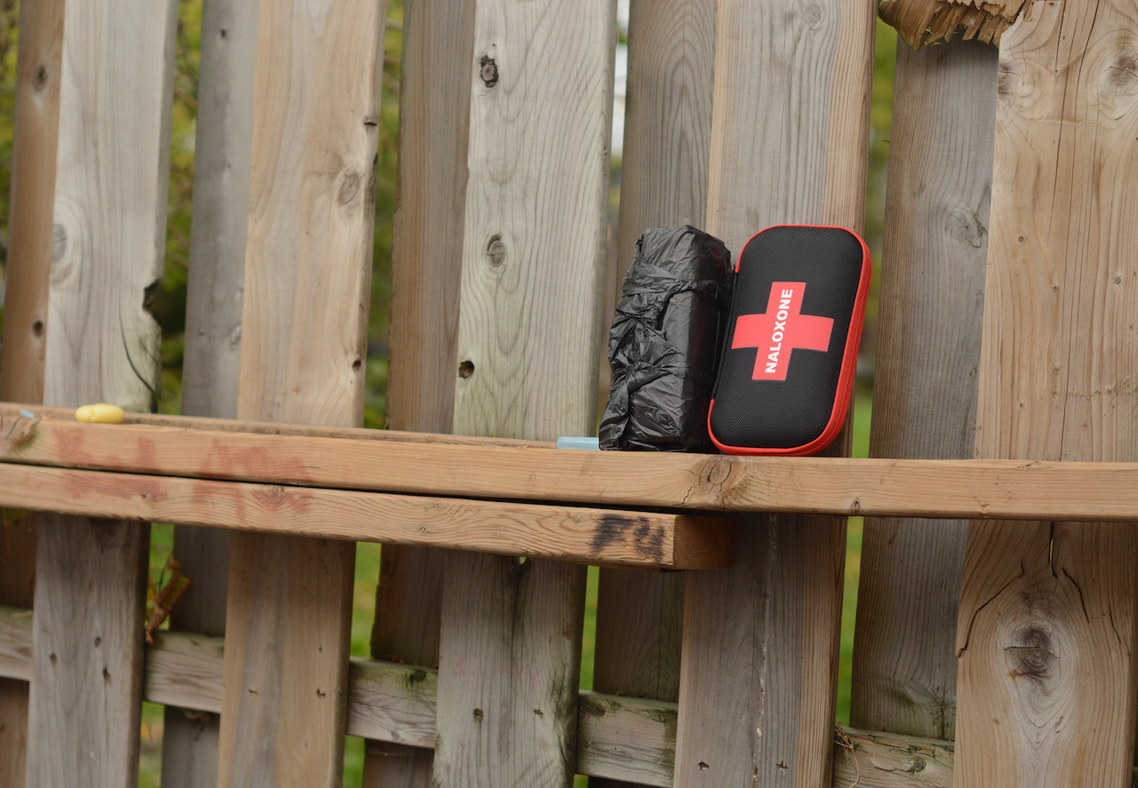 a naloxone kit on a fence