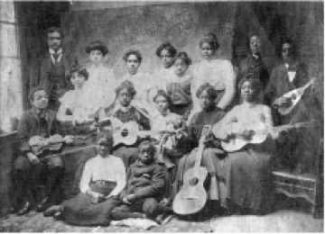 a group of women with a guitar