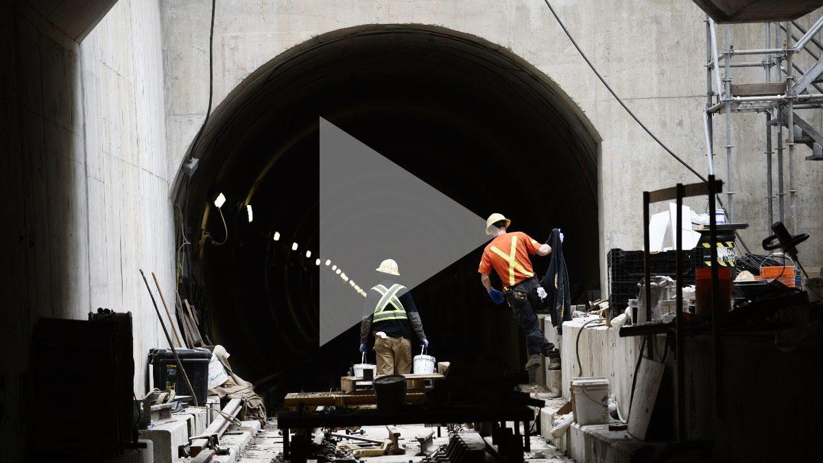 A man inside a construction tunnel.