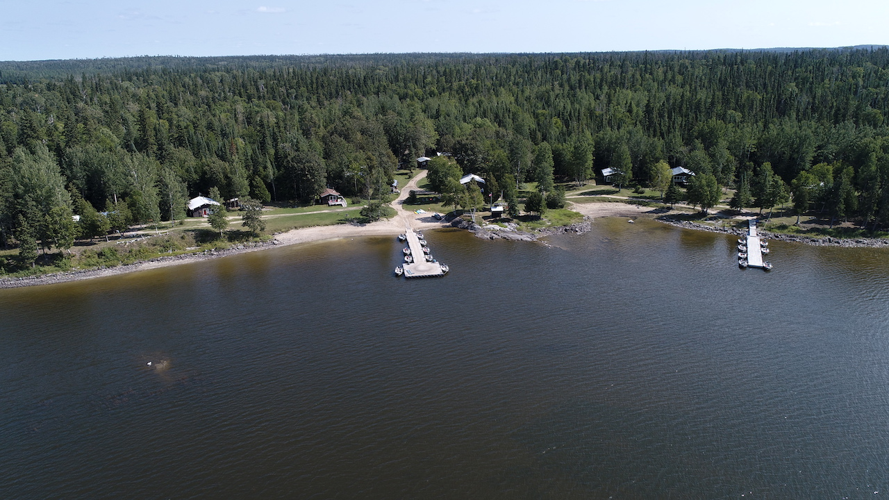 overhead shot of a lake with two docks in it