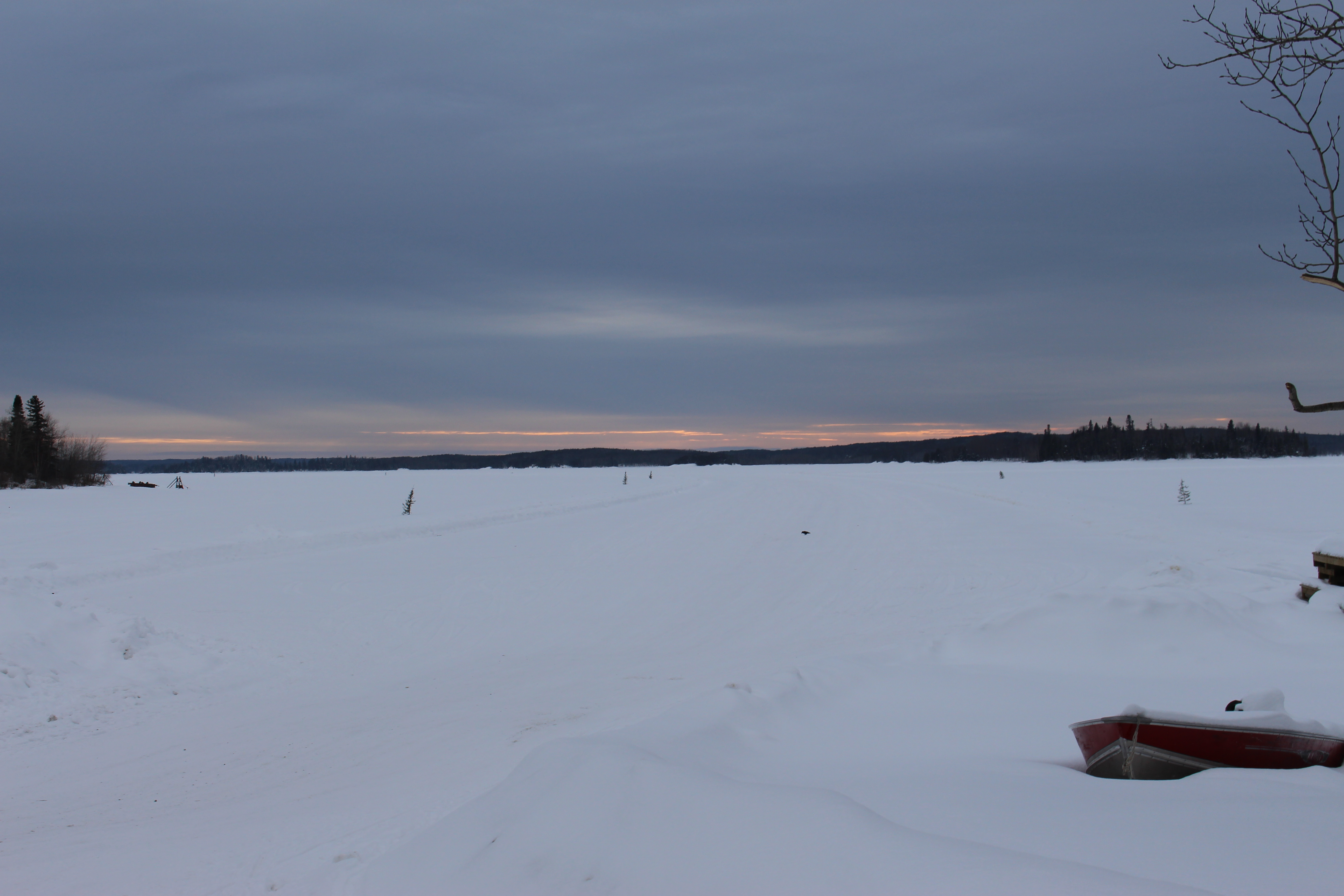 stretch of snow with a sunset