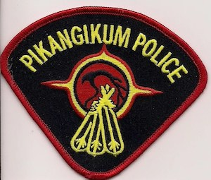 "badge reading ""Pikangikum Police"""