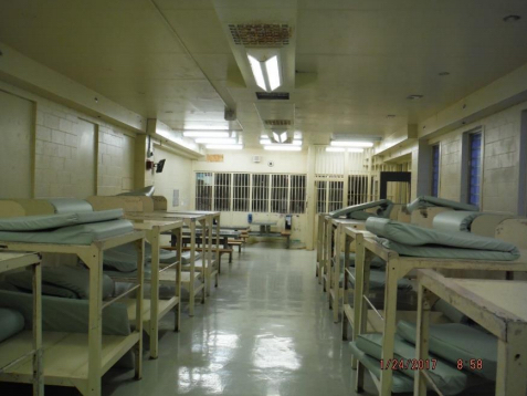 a row of bunkbeds with a phone on the wall