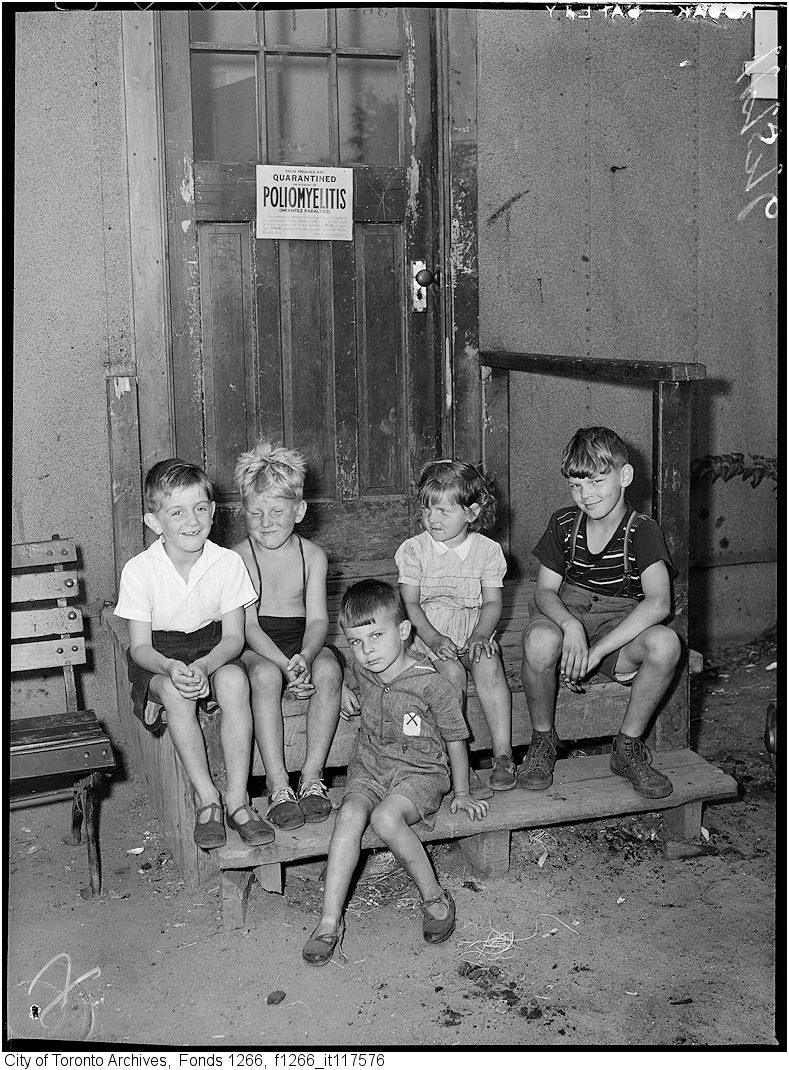 a group of children sit on a stoop