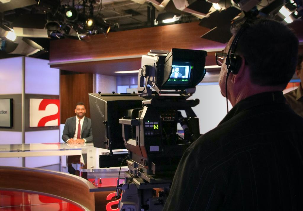 A man filming in The Agenda studio