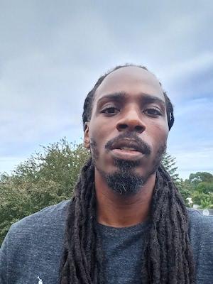 closeup of man with long dark hair