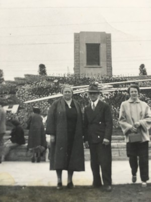 black and white photo of people standing in front of the floral clock
