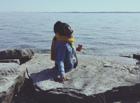 the author sitting by Lake Ontario
