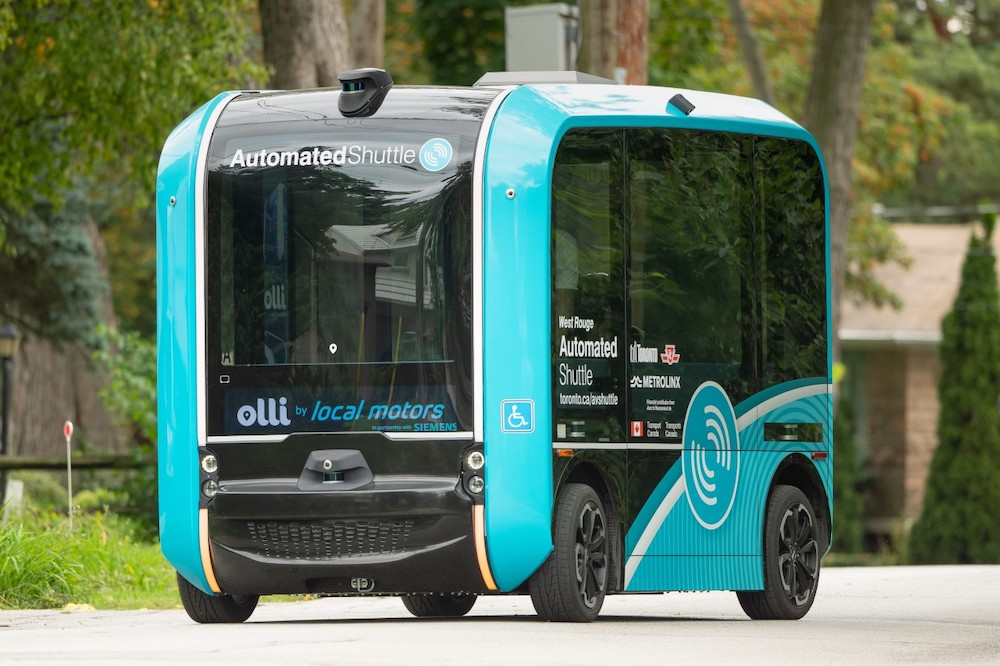 a small turquoise and black vehicle