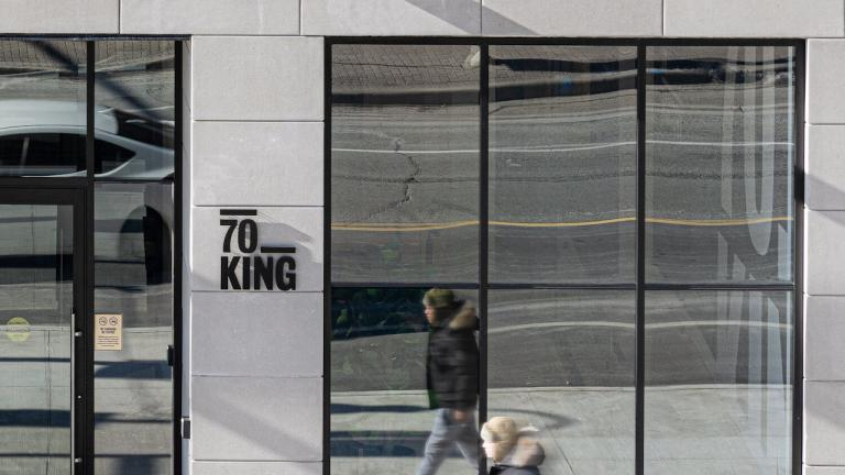man walks by the window of 70 King