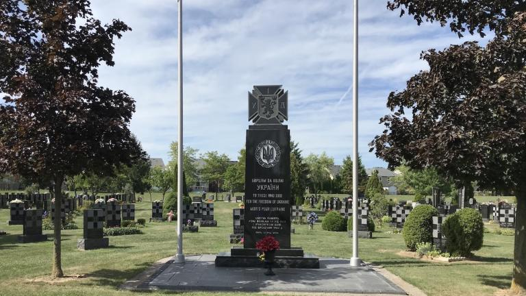 stone cenotaph with flags on either side