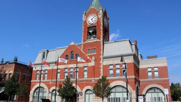 red brick building with clock tower from the article 'A cautionary tale': What this Ontario town can teach us about lobbyists