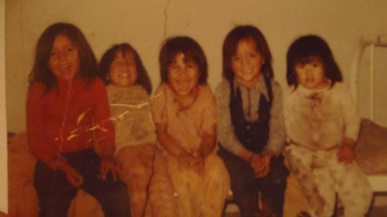 five children sitting on a bed from the article 'You belong in this world': Two-Spirit survivors share their stories