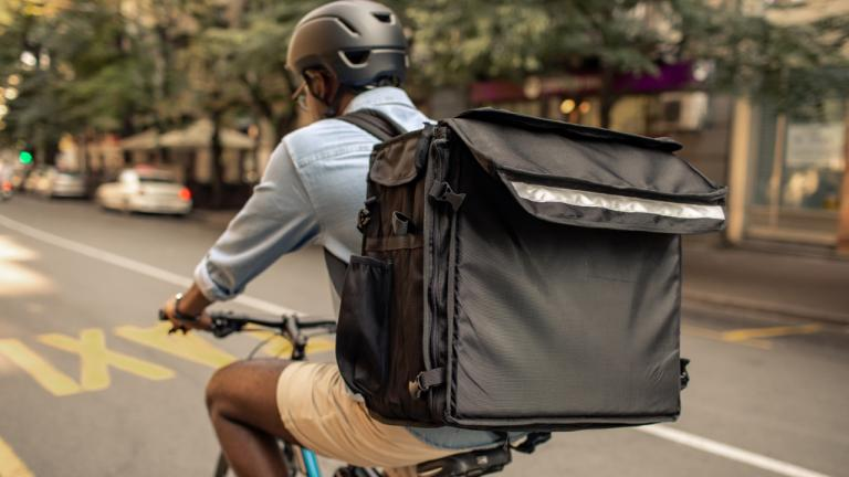 Uber Eats delivery person on a bicycle from the article How AI can help gig workers understand their rights