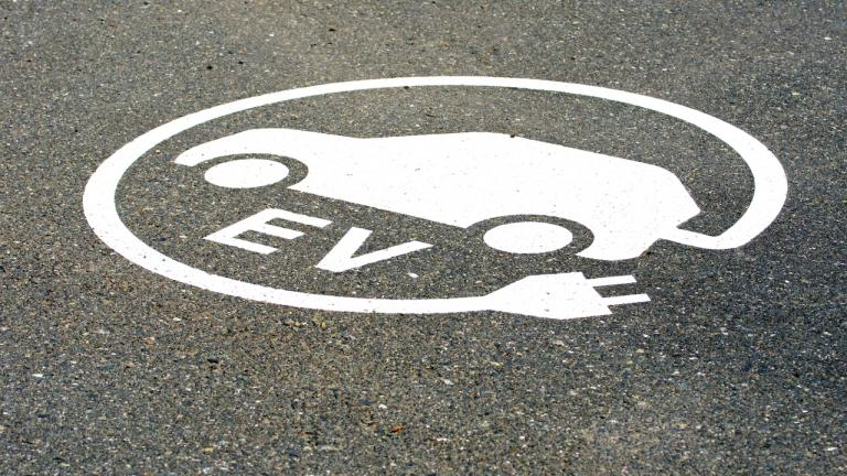 logo for an EV charging station painted on the street