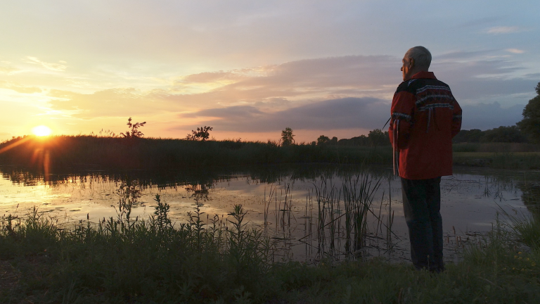 Douglas Cardinal by water from the article 'From Earth to Sky' A TVO Original film by Ron Chapman