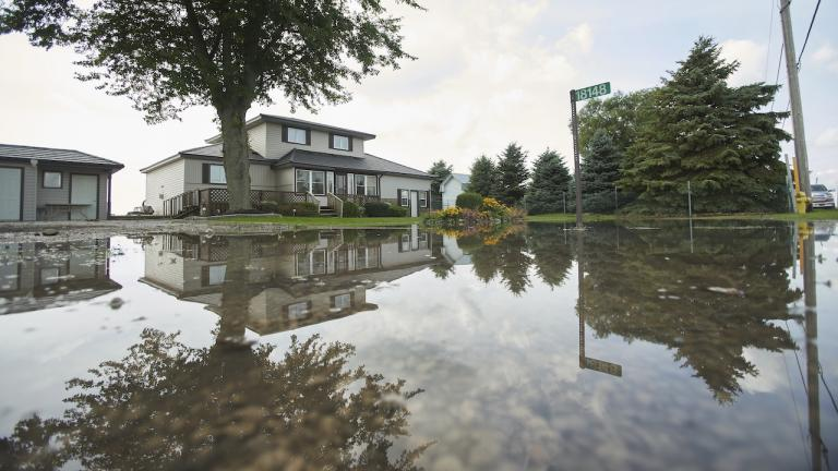 a house surrounded by trees and water from the article Why are municipal-insurance rates skyrocketing in Ontario?