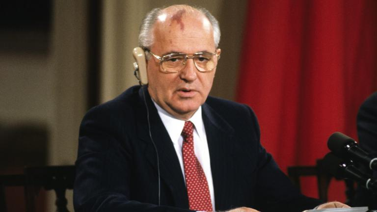 Man sitting at table, holding papers and speaking.  from the article Looking back on Mikhail Gorbachev's appearance on TVO