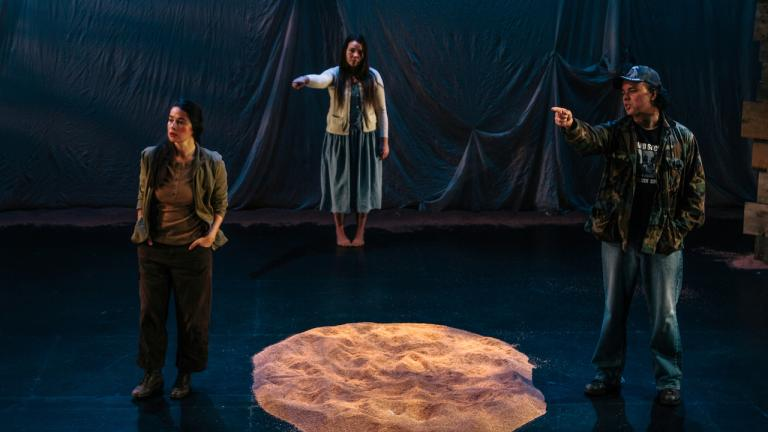 Two women and a man stand on a stage from the article 'The stories that people don't hear': A playwright reflects on the Ipperwash Crisis
