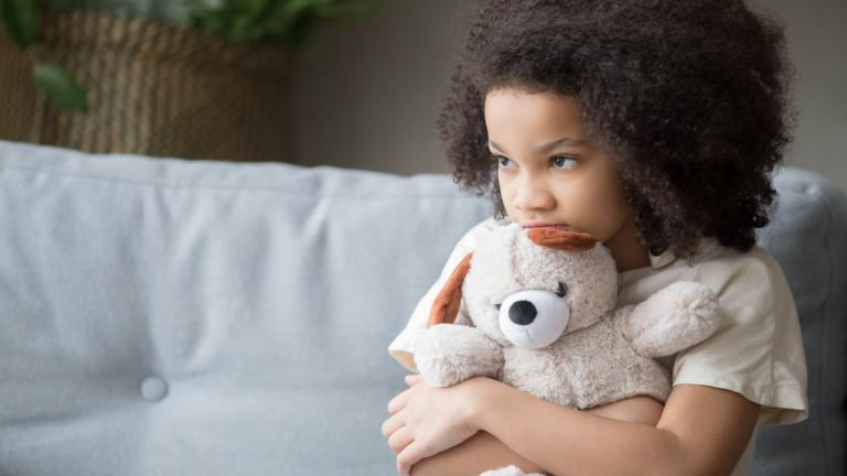 a child looking loney holding a teddy bear from the article Helping kids express gratitude during a difficult time