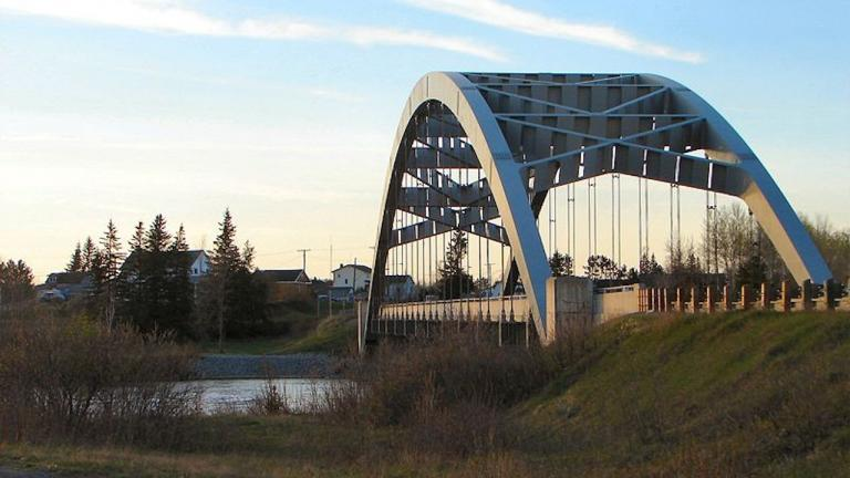 a bridge over water near a group of houses from the article How one tiny Ontario town makes the news
